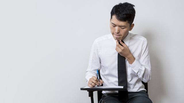 Chinese man taking an test or exam